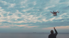 Custom drone hexacopter lands on your hands Stock Footage