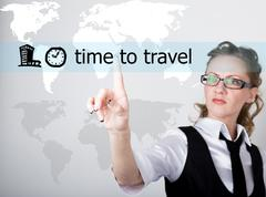 time to travel written on a virtual screen. Internet technologies in business - stock photo