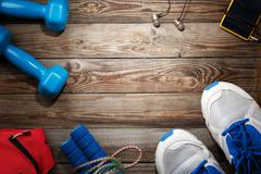 Sport stuff on wooden table, top view - stock photo