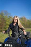 Elegant woman riding ATV Stock Photos