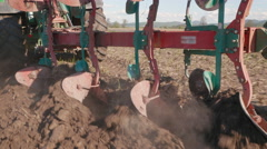 Close Up of Plow Breaking Up Soil Stock Footage