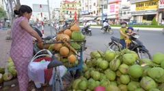 Coconut seller working at street.  Can Tho biggest city in Mekong Delta, Vietnam Stock Footage