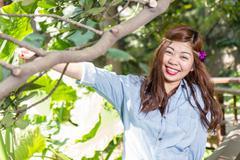 Filipina woman in a garden - stock photo