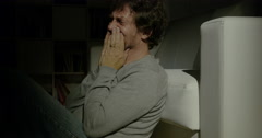 Desperate man crying at home at night Stock Footage