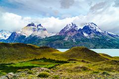 View of mountain and river in Torres Del Paine National Park Stock Photos