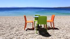 Beautiful beach & Sea & Table & Chairs Stock Footage