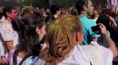 Holi Festival of colors. Funny girls making selfie - stock footage