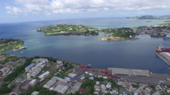 High angle above small islands and town - Caribbean Stock Footage