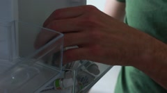 Taking a medicine from a fridge - stock footage