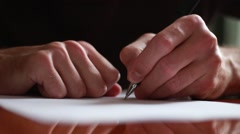 Writing a letter with left hand Stock Footage