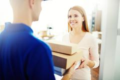 Delivering a parcel Stock Photos