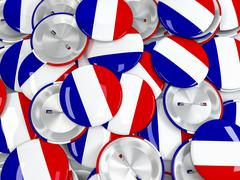 Top view on pile of button badges with flag of France. 3d render - stock illustration