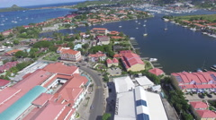 Slow tracking over Caribbean town and lake Stock Footage