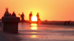 Five men silhouettes at sunset.Summer. ocean Beach Stock Footage
