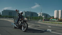 Business man riding a motorcycle in a city Stock Footage