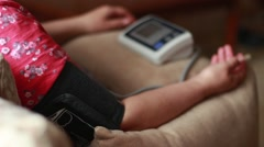 Woman checking the blood pressure with automatic tonometer Stock Footage