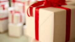Close-up shot of white gift boxes with a red ribbons Stock Footage