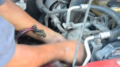 Professional automotive motor mechanic repair and inspecting the alternator Stock Footage