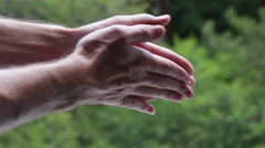 Man rubbing hand with hand Stock Footage