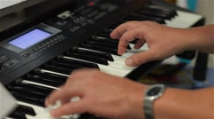 Man plays on synthesizer, hands close-up, party, disco Stock Footage