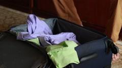 Man paking his suitcase untidy Stock Footage