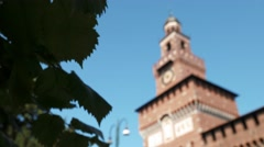 Milan sforza castle tower behind leaves moving in the breeze Stock Footage