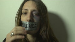 Beaten girl sits,fly cam to her face,she removed tape with mouth, break SILENCE. Stock Footage
