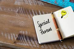 Classic fountain pen and open notebook on wooden table - stock photo