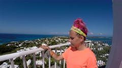 Girl passes around the observation deck of Gibbs Hill lighthouse. Bermuda. Stock Footage