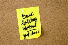 Bank Holiday Weekend Just Ahead written on yellow paper note - stock photo