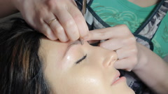 Beautician draws eyebrows - stock footage