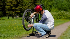 Man repairing Bicycle wheel - stock footage