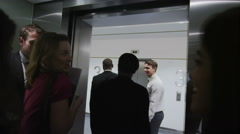 4K Business people step out of elevator in a modern corporate office building Stock Footage