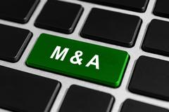 M&A or mergers and acquisitions button on keyboard Stock Photos