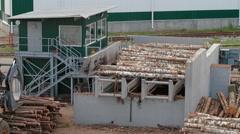 Lumber industry Conveyors of logs sorting machine Stock Footage