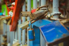 Close up on many love locks on fence Stock Photos