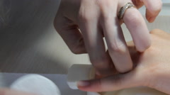 Young woman receiving a french manicure. Stock Footage