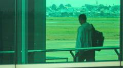 Passengers Board Liner through Loading Bridge in Terminal Stock Footage