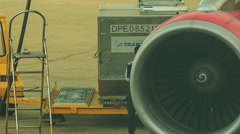 Airport Worker Walks by Ladder Plane Turbojet Engine Stock Footage