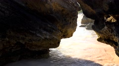 Pass among the rocks at the Bermuda beach. Stock Footage