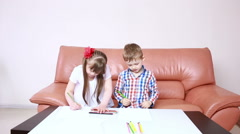 Two adorable happy children drawing with crayons at playschool. girl with Down Stock Footage