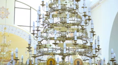 A large crystal chandelier in the church Stock Footage