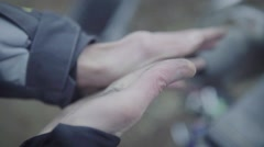 Biker wiping of grease from his hand Stock Footage