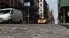 Cobble Stone with Taxi driving Stock Footage