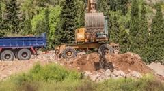 Large yellow excavator rake soil Stock Footage
