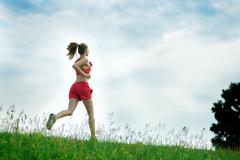 Young woman running summer park rural road. Outdoor exercises. J Kuvituskuvat