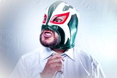 Manager, angry businessman with Mexican wrestler mask, expressions of anger a Stock Photos