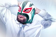 Worker, angry businessman with Mexican wrestler mask, expressions of anger an Stock Photos