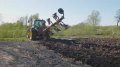 Tractor Turning the Plow at the End of the Field Stock Footage