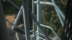 Lift climbing a steel tower in Milan Stock Footage